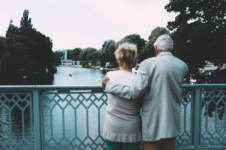 Old couple on bridge