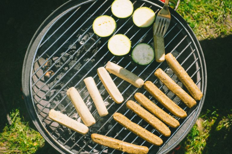 Vegan sausages and zucchini on grill