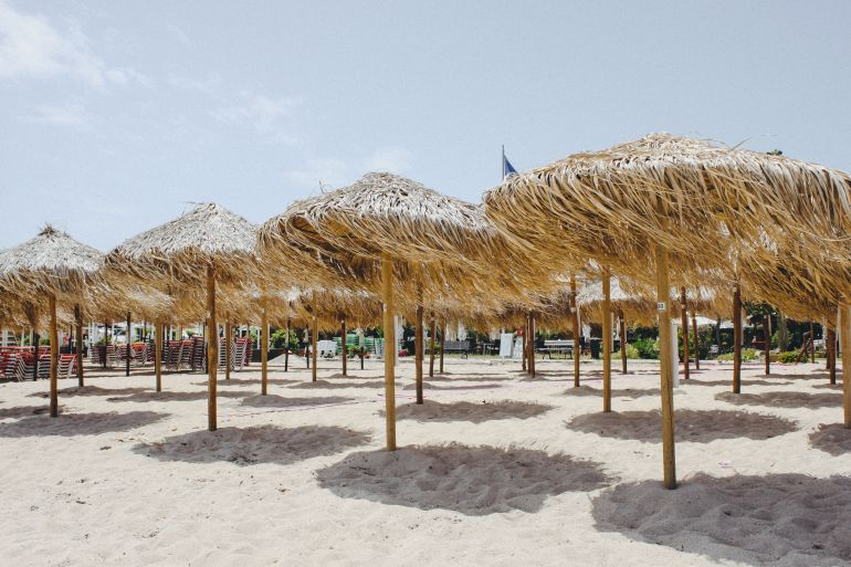 Thatched umbrellas on a beach