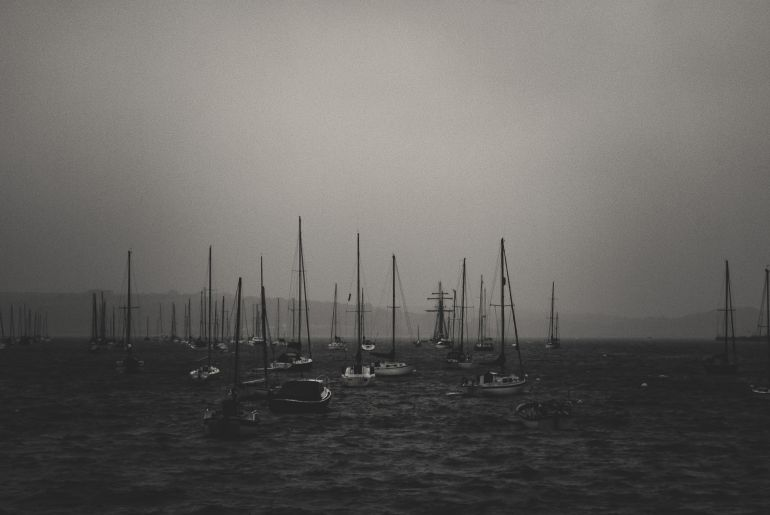 Yachts on river on an overcast day