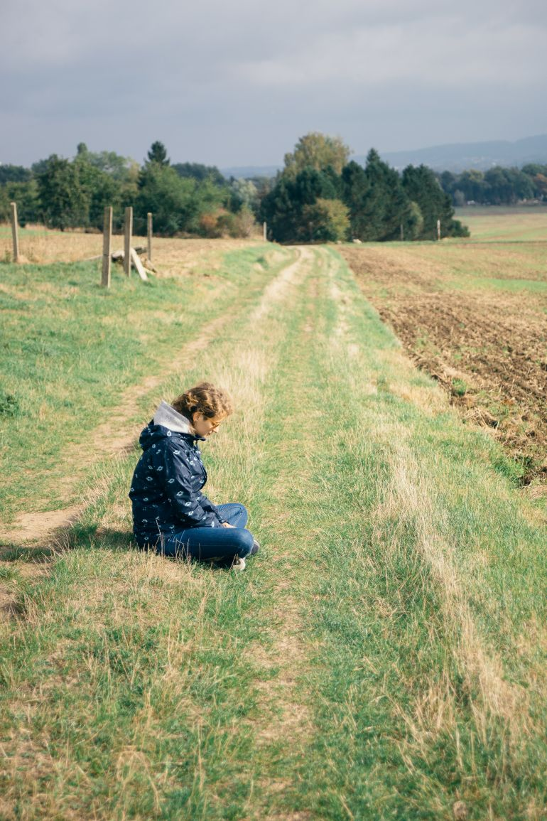 Woman sitting on ground