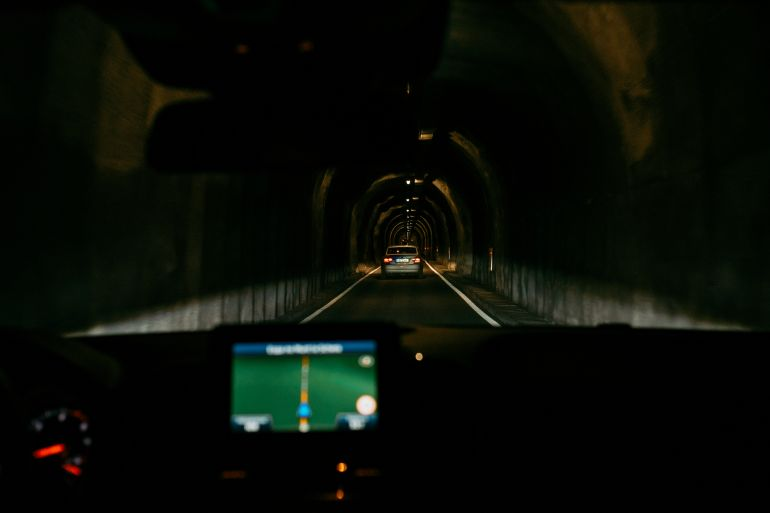 Driving through tunnel in Alps