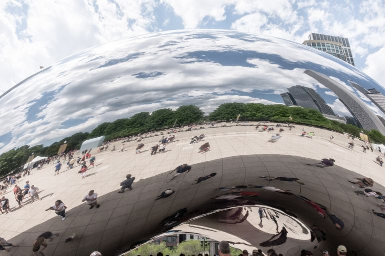 People reflecting on Chicago bean