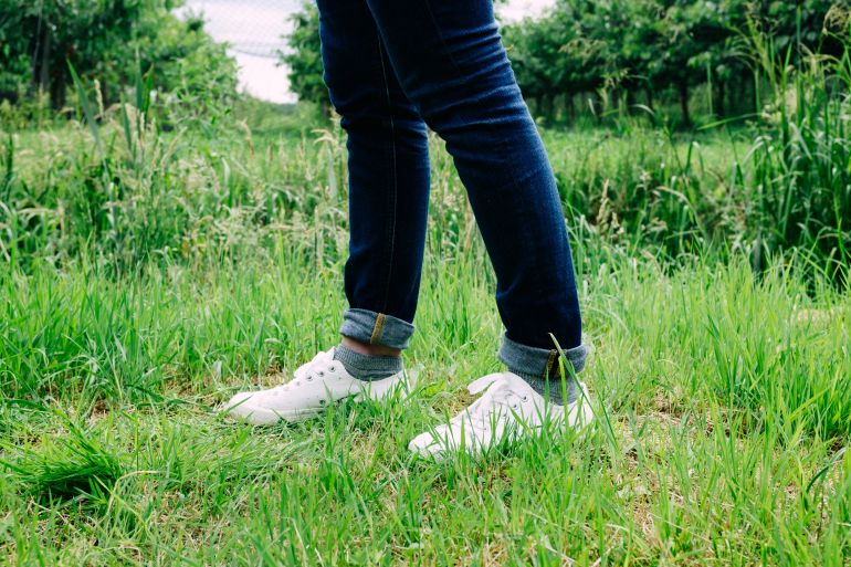 Wearing white sneakers in garden