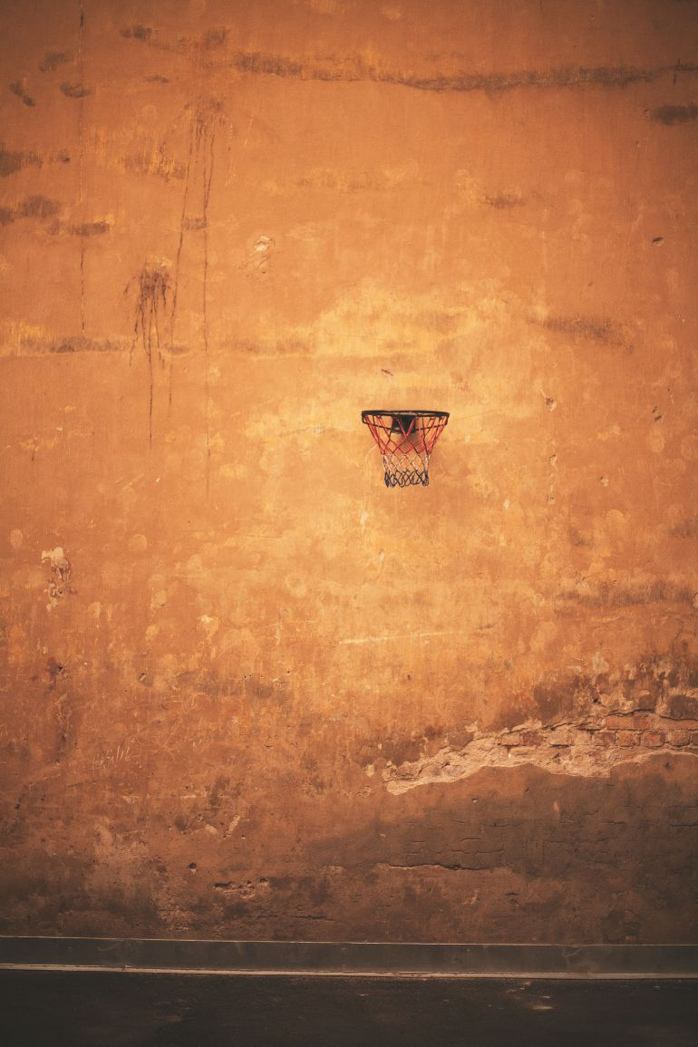 Old wall with basketball ring vertical