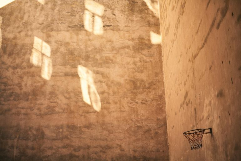 Basketball hoop and a textured wall