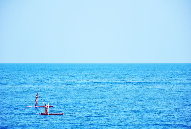Paddleboarding in the sea