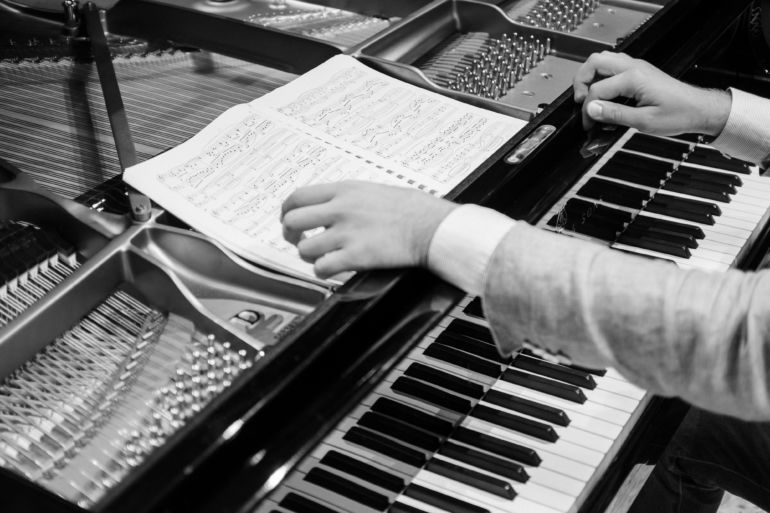 Hands of a pianist in black and white