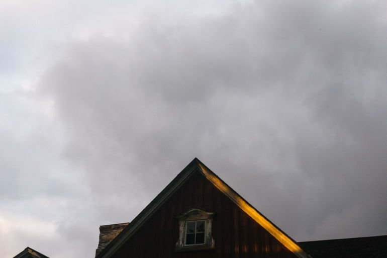 a strip of light on the roof and the evening sky