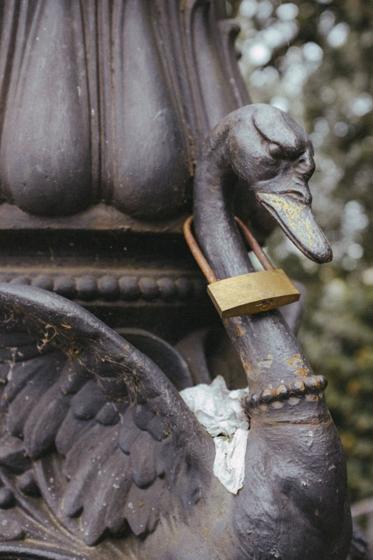 Sculpture of a swan with a lock on the neck