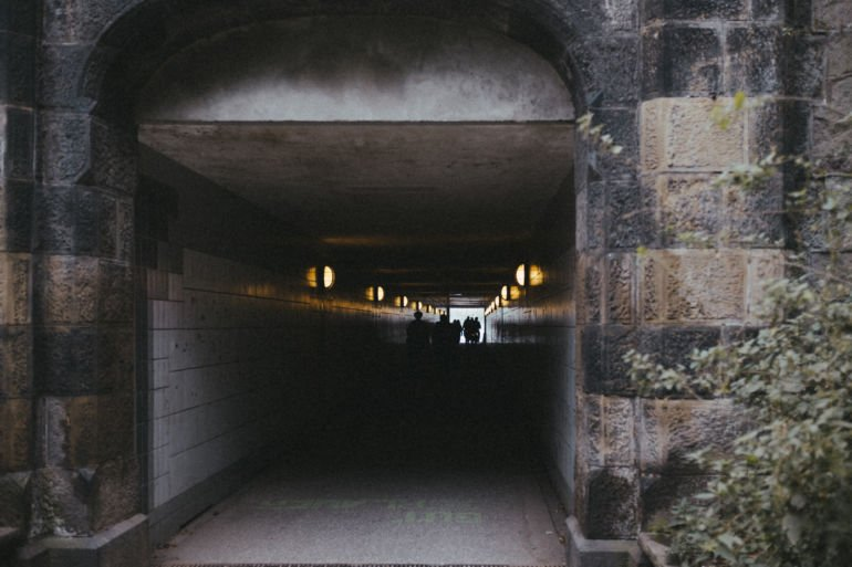 Tunnel and people silhouettes