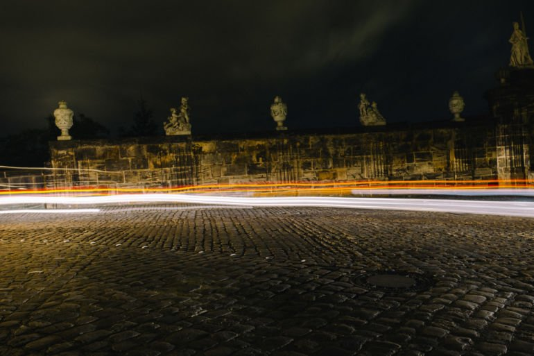 Abstract headlight lines in a medieval city