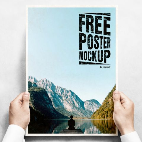 A free poster mockup with two hands holding a poster.