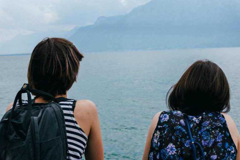 Two young women admiring Lake Geneva