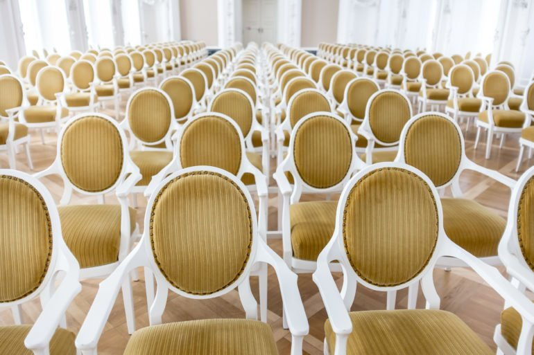 Empty chairs in a baroque concert hall