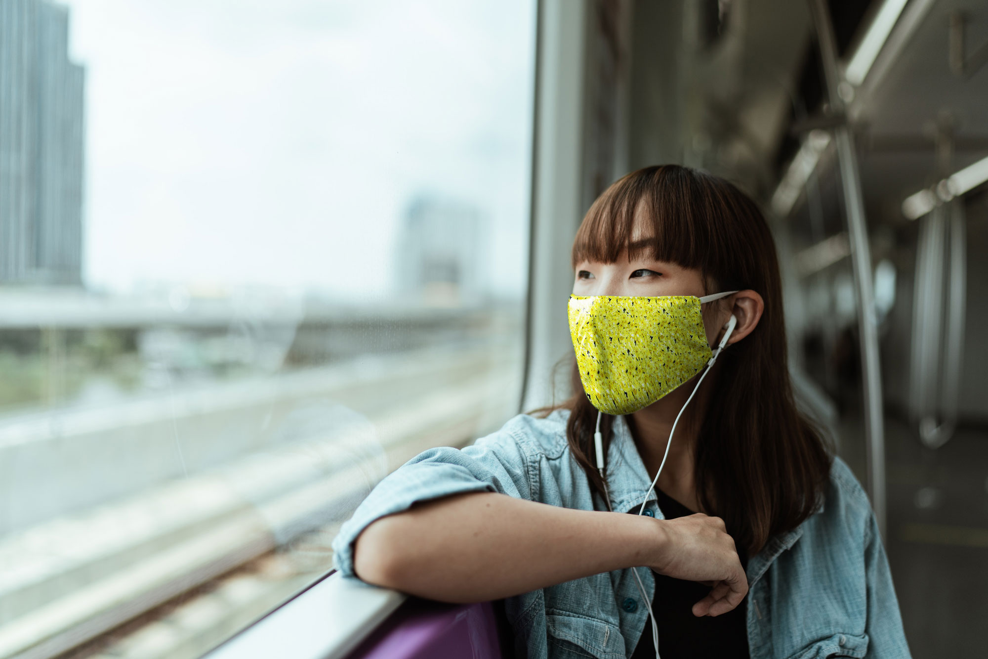 Mask Mockup With Young Woman in a Train
